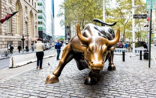 Bull Market, photo of charging metal bull in the NYC lower financial district