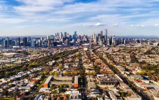 What the housing market holds for the future of private lending; picture of suburbs and city